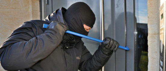 burglar breaking an entry